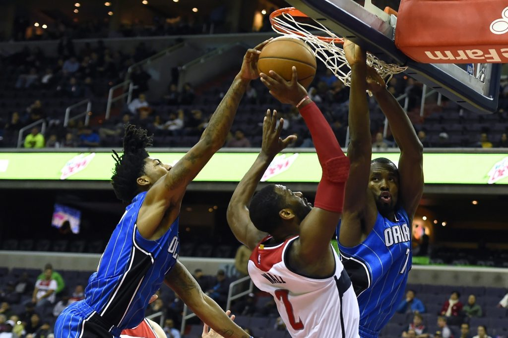 Dec 6, 2016; Washington, DC, USA; Orlando Magic guard Elfrid Payton (4) block Washington Wizards guard John Wall (2) shot as forward Serge Ibaka (7) defends the rim during the fourth quarter at Verizon Center. Orlando Magic defeated Washington Wizards 124-116. Mandatory Credit: Tommy Gilligan-USA TODAY Sports