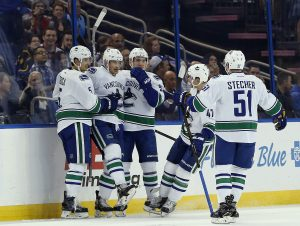 Dec 8, 2016; Tampa, FL, USA; Vancouver Canucks right wing Jack Skille (9) celebrates with teammates after scoring a goal against the Tampa Bay Lightning during the first period at Amalie Arena. Mandatory Credit: Kim Klement-USA TODAY Sports