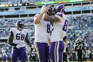 Dec 11, 2016; Jacksonville, FL, USA; Minnesota Vikings tight end Kyle Rudolph (82) celebrates scoring a touchdown with quarterback Sam Bradford (8) in the second half against the Jacksonville Jaguars at EverBank Field. The Vikings won 25-16. Mandatory Credit: Logan Bowles-USA TODAY Sports