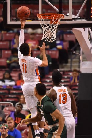 Dec 17, 2016; Sunrise, FL, USA; Florida Gators guard Chris Chiozza (11) attempts a lay up against the Charlotte 49ers during the first half at BB&T Center. Mandatory Credit: Jasen Vinlove-USA TODAY Sports