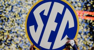 hi-res-454230113-the-auburn-tigers-hold-up-the-sec-sign-in-celebration_crop_north