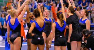 """The Florida Gators gather together before the start of the meet against Georgia.  Florida Gators Gymnastics vs Georgia Bulldogs.  January 30th, 2015. Gator Country photo by David Bowie."""