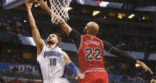 Mar 26, 2016; Orlando, FL, USA; Chicago Bulls forward Taj Gibson (22) tries to block the shot of Orlando Magic guard Evan Fournier (10) during the second half of a basketball game at Amway Center. The Magic won 111-89. Mandatory Credit: Reinhold Matay-USA TODAY Sports