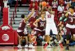 Jan 27, 2016; Fayetteville, AR, USA; Arkansas Razorbacks forward Moses Kingsley (33) looks to pass the ball while being guarded by Texas A&M Aggies guard Anthony Collins (11) and Aggies center Tyler Davis (34) during the first half at Bud Walton Arena. Mandatory Credit: Gunnar Rathbun-USA TODAY Sports