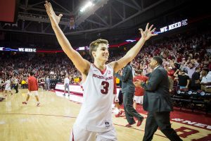 Jan 27, 2016; Fayetteville, AR, USA; Arkansas Razorbacks guard Dusty Hannahs (3) raises his arms in celebration after the Razorbacks game with the Texas A&M Aggies at Bud Walton Arena. The Razorbacks won 74-71. Mandatory Credit: Gunnar Rathbun-USA TODAY Sports