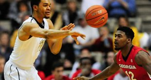 Feb 20, 2016; Nashville, TN, USA; Vanderbilt Commodores forward Jeff Roberson (11) passes the ball away from Georgia Bulldogs guard Kenny Gaines (12) during the first half at Memorial Gym. Mandatory Credit: Joshua Lindsey-USA TODAY Sports