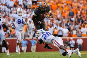 Sep 24, 2016; Knoxville, TN, USA; Tennessee Volunteers quarterback Joshua Dobbs (11) runs the ball against Florida Gators defensive back Marcus Maye (20) during the second half at Neyland Stadium. Tennessee won 38-28. Mandatory Credit: Randy Sartin-USA TODAY Sports