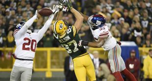 Oct 9, 2016; Green Bay, WI, USA;  Green Bay Packers wide receiver Jordy Nelson (87) tries to catch a pass between New York Giants cornerback Janoris Jenkins (20) and safety Andrew Adams (33) in the second quarter that fell incomplete at Lambeau Field. Mandatory Credit: Benny Sieu-USA TODAY Sports