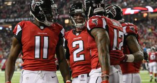 Jan 1, 2017; Atlanta, GA, USA; Atlanta Falcons wide receiver Mohamed Sanu (12) reacts with wide receiver Julio Jones (11) and quarterback Matt Ryan (2) after catching a touchdown pass against the New Orleans Saints during the first half at the Georgia Dome. Mandatory Credit: Dale Zanine-USA TODAY Sports