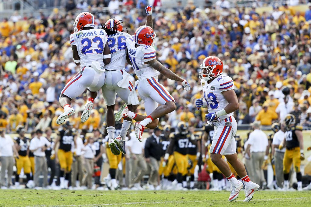 Jan 2, 2017; Tampa , FL, USA; Florida Gators defensive back Chauncey Gardner (23) celebrates with defensive back Marcell Harris (26) and defensive back Teez Tabor (31) after a play in the second quarter against the Iowa Hawkeyes at Raymond James Stadium. Mandatory Credit: Logan Bowles-USA TODAY Sports