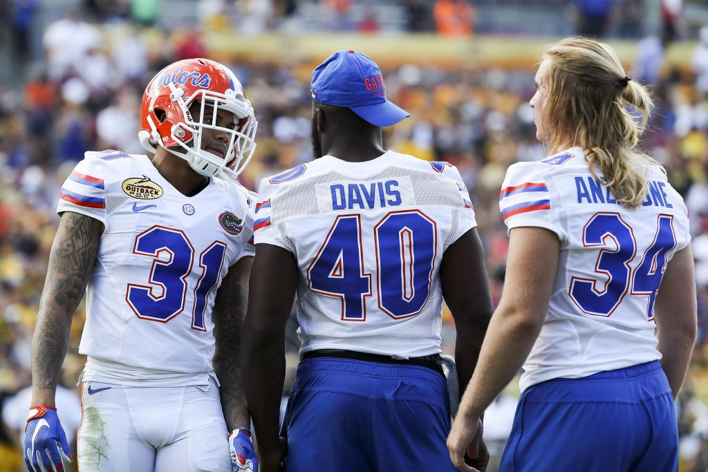 Jan 2, 2017; Tampa , FL, USA; Florida Gators defensive back Teez Tabor (31) talks with linebacker Jarrad Davis (40) and linebacker Alex Anzalone (34) during a timeout in the second quarter against the Iowa Hawkeyes at Raymond James Stadium. Mandatory Credit: Logan Bowles-USA TODAY Sports