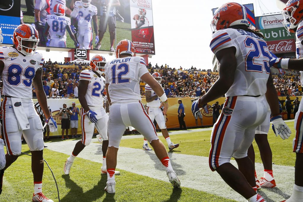 Jan 2, 2017; Tampa , FL, USA; Florida Gators quarterback Austin Appleby (12) celebrates with teammates after scoring a touchdown in the second quarter against the Iowa Hawkeyes at Raymond James Stadium. Mandatory Credit: Logan Bowles-USA TODAY Sports