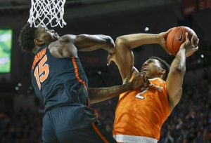 Jan 7, 2017; Gainesville, FL, USA; Florida Gators center John Egbunu (15) tries to block the shot from Tennessee Volunteers forward Grant Williams (2) during the first half of an NCAA men's basketball game in the Exactech Arena at the Stephen C. O'Connell Center. Mandatory Credit: Reinhold Matay-USA TODAY Sports