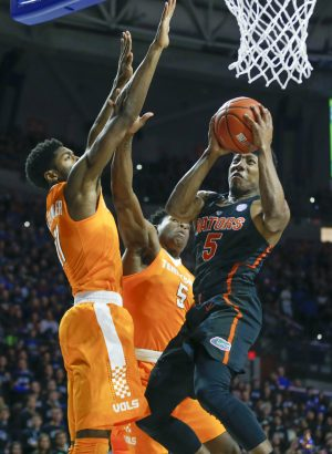 Jan 7, 2017; Gainesville, FL, USA; Florida Gators guard KeVaughn Allen (right) shoots despite block attempts by Tennessee Volunteers forward Kyle Alexander (11) and forward Admiral Schofield (center) during the first half of an NCAA men's basketball game in the Exactech Arena at the Stephen C. O'Connell Center. Mandatory Credit: Reinhold Matay-USA TODAY Sports