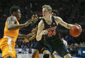 Jan 7, 2017; Gainesville, FL, USA; Florida Gators guard Canyon Barry (24) drives up to Tennessee Volunteers forward Admiral Schofield (5) during the first half of an NCAA men's basketball game in the Exactech Arena at the Stephen C. O'Connell Center. Mandatory Credit: Reinhold Matay-USA TODAY Sports