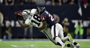 Jan 7, 2017; Houston, TX, USA; Oakland Raiders wide receiver Andre Holmes (18) is tackled by Houston Texans cornerback Johnathan Joseph (24) during the fourth quarter of the AFC Wild Card playoff football game at NRG Stadium. Mandatory Credit: Jerome Miron-USA TODAY Sports