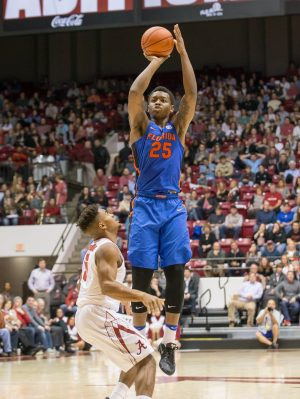 Jan 10, 2017; Tuscaloosa, AL, USA; Florida Gators forward Keith Stone (25) shoots over Alabama Crimson Tide guard Avery Johnson Jr. (5) at Coleman Coliseum. Mandatory Credit: Marvin Gentry-USA TODAY Sports