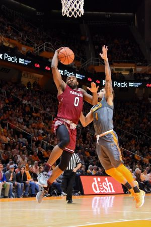 Jan 11, 2017; Knoxville, TN, USA; South Carolina Gamecocks guard Sindarius Thornwell (0) goes to the basket against Tennessee Volunteers guard Lamonte Turner (1) during the second half at Thompson-Boling Arena. South Carolina won 70 to 60. Mandatory Credit: Randy Sartin-USA TODAY Sports