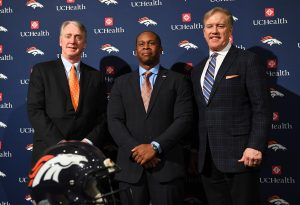 Jan 12, 2017; Englewood, CO, USA; Denver Broncos head coach Vance Joseph (center) and general manager John Elway (right) and president Joe Ellis pose for a photo following a press conference at UCHealth Training Center. Mandatory Credit: Ron Chenoy-USA TODAY Sports