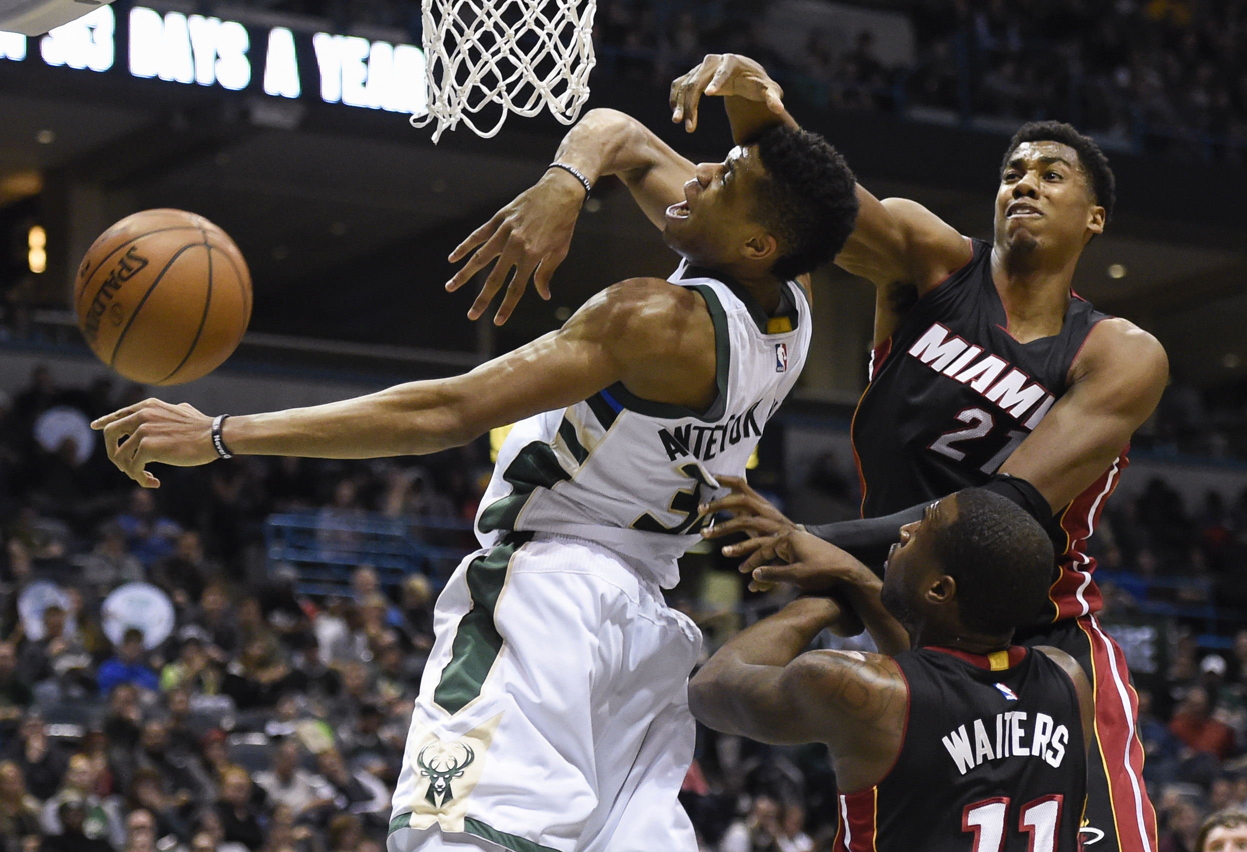 Jan 13, 2017; Milwaukee, WI, USA; Milwaukee Bucks forward Giannis Antetokounmpo (34) battles for a rebound against Miami Heat guard Wayne Ellington (2) and guard Dion Waiters (11) in the fourth quarter at BMO Harris Bradley Center. Mandatory Credit: Benny Sieu-USA TODAY Sports