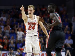 Jan 14, 2017; Gainesville, FL, USA; Florida Gators guard Canyon Barry (24) points as Georgia Bulldogs forward Pape Diatta (5) looks on after he made a there pointer during the first half at Exactech Arena at the Stephen C. O'Connell Ce. Mandatory Credit: Kim Klement-USA TODAY Sports