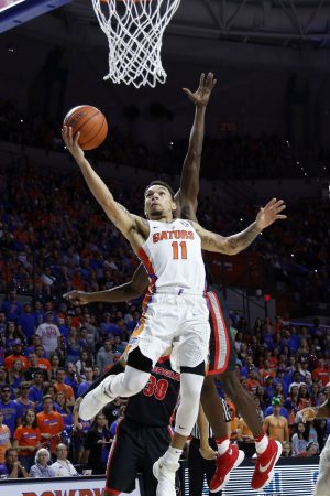 Jan 14, 2017; Gainesville, FL, USA; Florida Gators guard Chris Chiozza (11) drives to the basket past Georgia Bulldogs guard Jordan Harris (2) during the first half at Exactech Arena at the Stephen C. O'Connell Ce. Mandatory Credit: Kim Klement-USA TODAY Sports