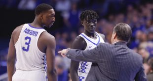 Jan 14, 2017; Lexington, KY, USA; Kentucky Wildcats head coach John Calipari talks with forward Edrice Bam Adebayo (3) and forward Wenyen Gabriel (32) during the game against the Auburn Tigers in the second half at Rupp Arena. Kentucky defeated Auburn 92-72. Mandatory Credit: Mark Zerof-USA TODAY Sports