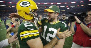 Jan 15, 2017; Arlington, TX, USA; Green Bay Packers quarterback Aaron Rodgers (12) celebrates with kicker Mason Crosby (2) after beating the Dallas Cowboys in the NFC Divisional playoff game at AT&T Stadium. Mandatory Credit: Dan Powers/The Post-Crescant via USA TODAY NETWORK