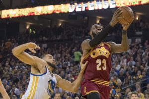 January 16, 2017; Oakland, CA, USA; Cleveland Cavaliers forward LeBron James (23) shoots the basketball against Golden State Warriors center JaVale McGee (1) during the first quarter at Oracle Arena. Mandatory Credit: Kyle Terada-USA TODAY Sports
