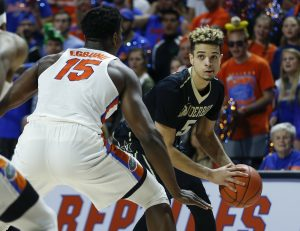 Jan 21, 2017; Gainesville, FL, USA; Vanderbilt Commodores guard Matthew Fisher-Davis (5) looks to pass around Florida Gators center John Egbunu (15) during the first half of an NCAA basketball game at Exactech Arena at the Stephen C. O'Connell Center. Mandatory Credit: Reinhold Matay-USA TODAY Sports