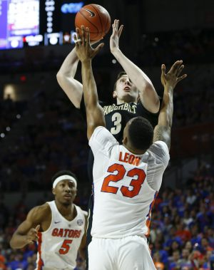 Jan 21, 2017; Gainesville, FL, USA; Vanderbilt Commodores forward Luke Kornet (3) shoots over Florida Gators forward Justin Leon (23) as guard KeVaughn Allen (5) looks on during the first half of an NCAA basketball game at Exactech Arena at the Stephen C. O'Connell Center. Mandatory Credit: Reinhold Matay-USA TODAY Sports
