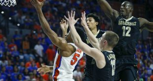 Jan 21, 2017; Gainesville, FL, USA;Florida Gators guard KeVaughn Allen (5) drives and shoots past Vanderbilt Commodores guard Riley LaChance (13) and center Djery Baptiste (12) and guard Payton Willis (1) during the first half of an NCAA basketball game at Exactech Arena at the Stephen C. O'Connell Center. Mandatory Credit: Reinhold Matay-USA TODAY Sports