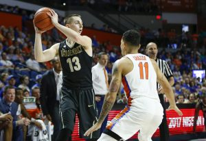 Jan 21, 2017; Gainesville, FL, USA;Vanderbilt Commodores guard Riley LaChance (13) controls the ball against Florida Gators guard Chris Chiozza (11) during the first half of an NCAA basketball game at Exactech Arena at the Stephen C. O'Connell Center. Mandatory Credit: Reinhold Matay-USA TODAY Sports