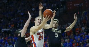 Jan 21, 2017; Gainesville, FL, USA; Florida Gators guard Canyon Barry (24) drives and shoots between Vanderbilt Commodores guard Matthew Fisher-Davis (5) and Vanderbilt Commodores forward Luke Kornet (3) during the second half of an NCAA basketball game at Exactech Arena at the Stephen C. O'Connell Center. Vanderbilt won 68-66.Mandatory Credit: Reinhold Matay-USA TODAY Sports