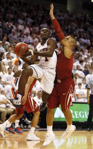Jan 21, 2017; Auburn, AL, USA; Auburn Tigers guard Jared Harper (1) shoots around Alabama Crimson Tide guard Corbin Collins (3) during the second half at Auburn Arena. The Tigers beat the Tide 84-64. Mandatory Credit: John Reed-USA TODAY Sports