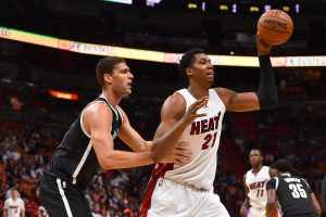 Jan 30, 2017; Miami, FL, USA; Miami Heat center Hassan Whiteside (21) controls the ball around Brooklyn Nets center Brook Lopez (11) during the first half at American Airlines Arena. Mandatory Credit: Jasen Vinlove-USA TODAY Sports