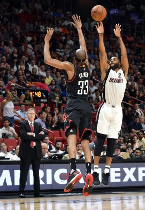 Jan 17, 2017; Miami, FL, USA; Houston Rockets head coach Mike D'Antoni (left) watches as Miami Heat guard Wayne Ellington (right) make a three point basket over Houston Rockets forward Corey Brewer (33) during the second half at American Airlines Arena. The Heat won 109-103. Mandatory Credit: Steve Mitchell-USA TODAY Sports