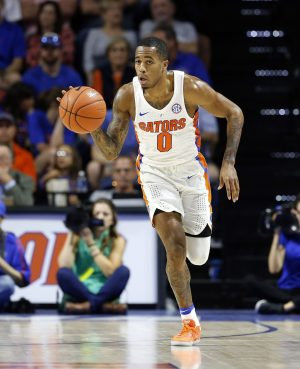 Jan 14, 2017; Gainesville, FL, USA; Florida Gators guard Kasey Hill (0) dribbles the ball against the Georgia Bulldogs during the first half at Exactech Arena at the Stephen C. O'Connell Ce. Mandatory Credit: Kim Klement-USA TODAY Sports
