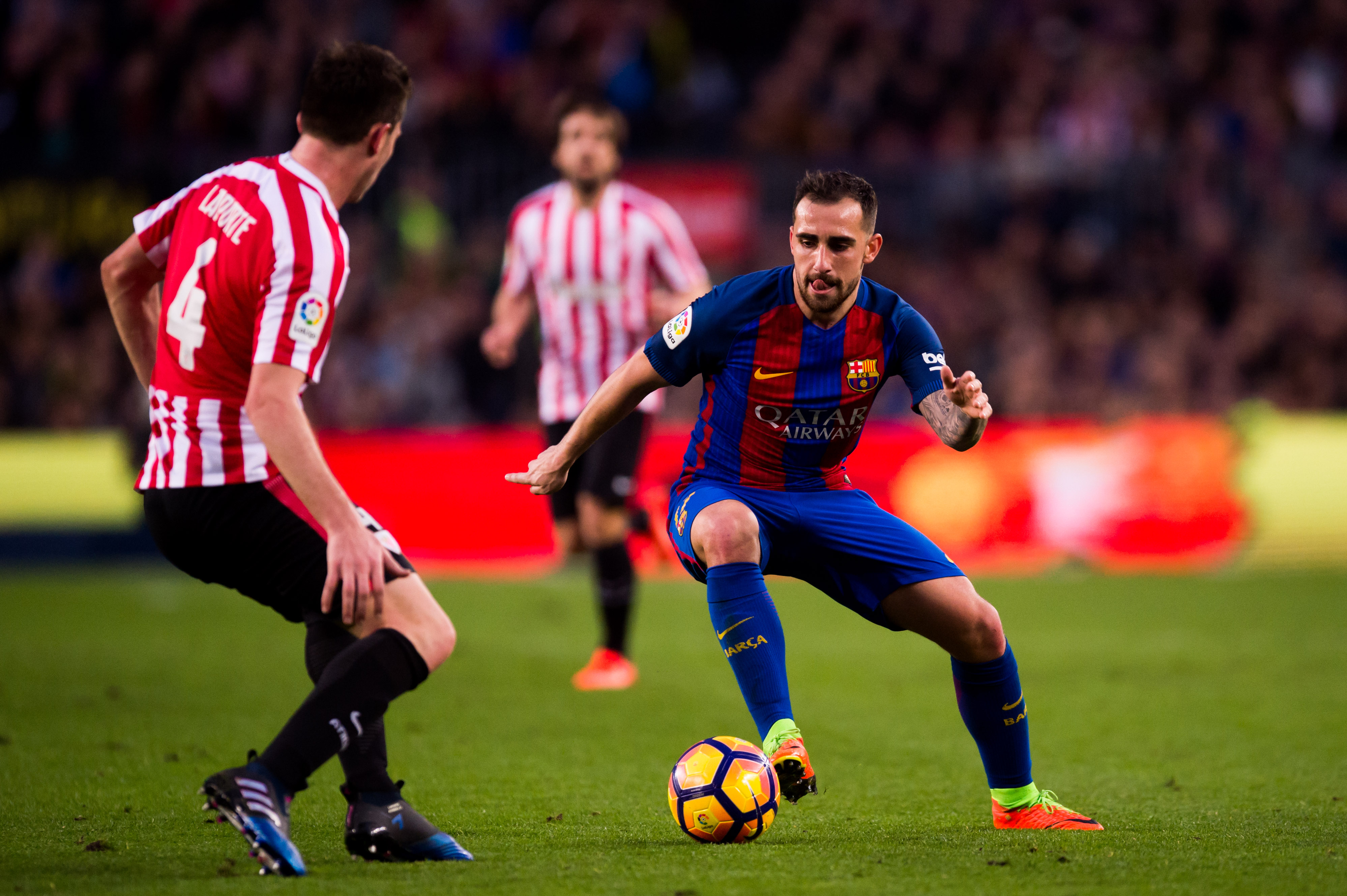 BARCELONA, SPAIN - FEBRUARY 04: Paco Alcacer of FC Barcelona dribbles Aymeric Laporte of Athletic Club during the La Liga match between FC Barcelona and Athletic Club at Camp Nou stadium on February 4, 2017 in Barcelona, Spain. (Photo by Alex Caparros/Getty Images)