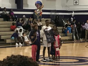 Hurricanes Derek Owens with his family are honored during Senior Night