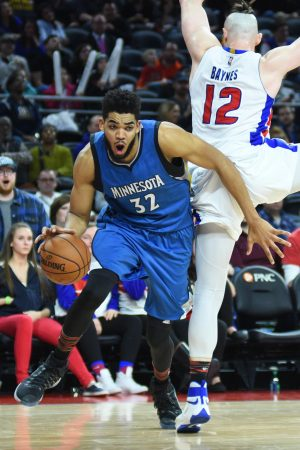 Feb 3, 2017; Auburn Hills, MI, USA; Minnesota Timberwolves center Karl-Anthony Towns (32) drives past Detroit Pistons center Aron Baynes (12) during the fourth quarter at The Palace of Auburn Hills. Mandatory Credit: Tim Fuller-USA TODAY Sports
