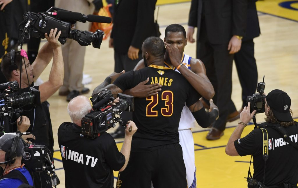 premium selection 0464e 6a059 Jun 12, 2017  Oakland, CA, USA  Golden State Warriors forward Kevin Durant  (35) hugs Cleveland Cavaliers forward LeBron James (23) after game five of  the ...
