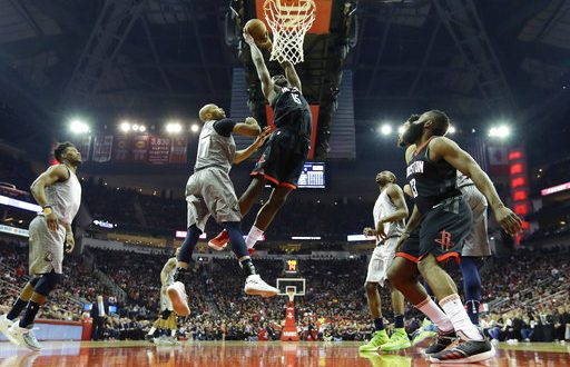 058931bff2cb Houston Rockets  Clint Capela dunks the ball over Minnesota Timberwolves   Taj Gibson during the first half in Game 1 of a first-round NBA basketball  playoff ...