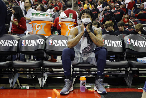 fa31e49a3fca Minnesota Timberwolves  Derrick Rose sits on the bench during a timeout  against the Houston Rockets in the second half in Game 1 of a first-round  NBA ...