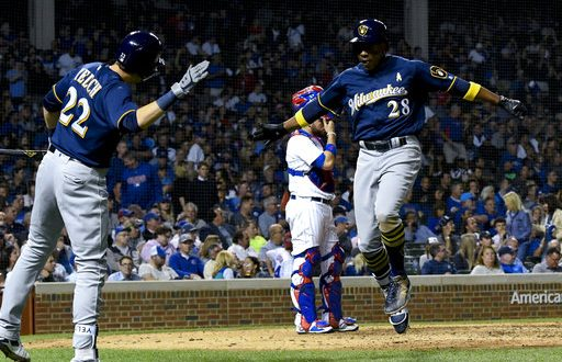 1042438ac Milwaukee Brewers  Curtis Granderson (28) high fives Christian Yelich (22)  after Granderson hit a home run during the ninth inning of a baseball game  ...