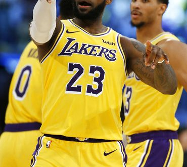 b150ba4bc Los Angeles Lakers forward LeBron James congratulates a pass by guard Lance  Stephenson for a James  dunk during the second half of an NBA basketball  game ...