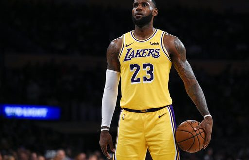 0bc23eb55958 Los Angeles Lakers forward LeBron James attempts a free throw during the  first half of an NBA preseason basketball game against the Sacramento Kings  in Los ...