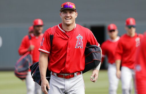 b13529e94 Los Angeles Angels' Mike Trout smiles as he walks onto the field with  teammates before a spring training baseball game against the Arizona  Diamondbacks ...