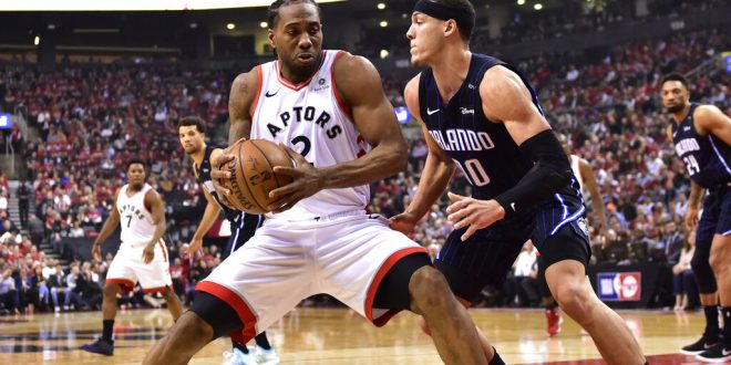 1e7643cdc1f08 Raptors even series with Magic at 1-1 behind Leonard s 37 points ...