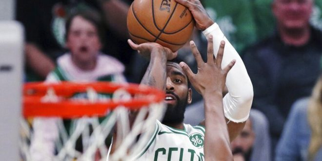 f356523e7c24 Boston Celtics guard Kyrie Irving (11) shoots over Indiana Pacers center  Myles Turner (33) during the first quarter of Game 2 of an NBA basketball  ...